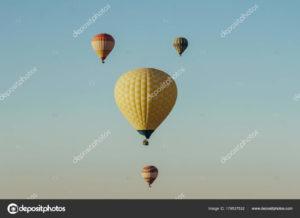 depositphotos_179537532-stock-photo-hot-air-balloons-flying-blue