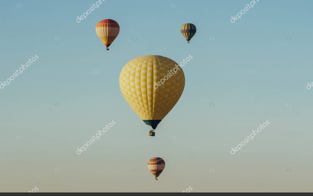 depositphotos_179537532-stock-photo-hot-air-balloons-flying-blue